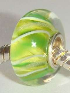 This auction is for one LIMON YELLOW GREEN MURANO GLASS EUROPEAN BEAD